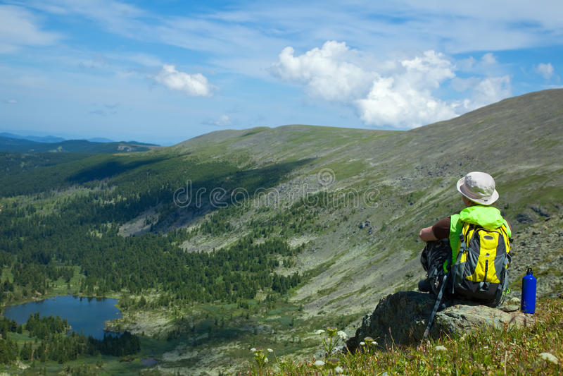 Woman on mountain peak royalty free stock images