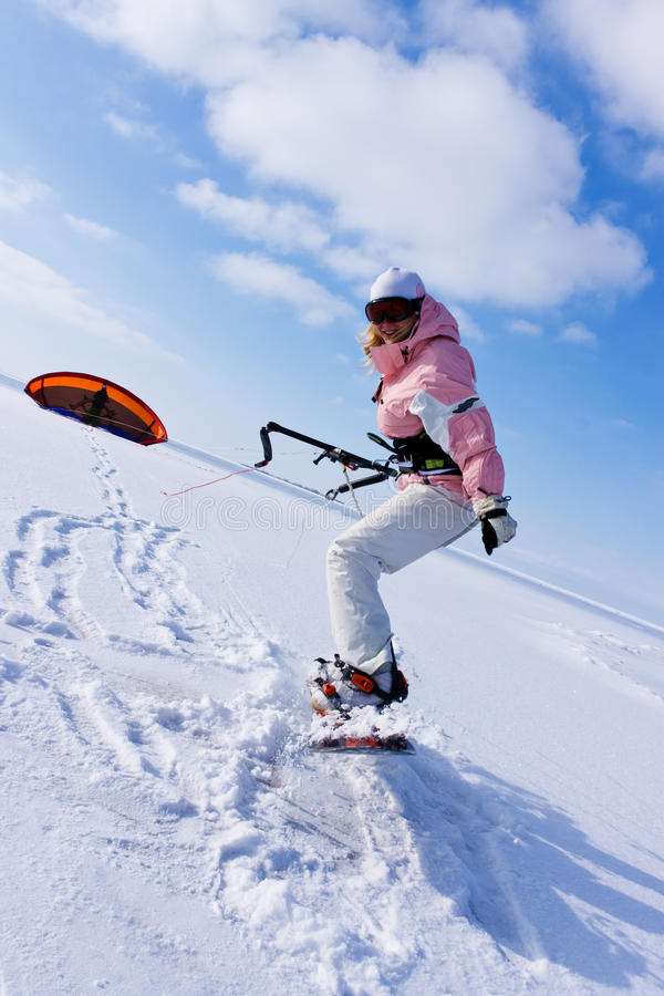 Woman on a mountain slope in winter stock image