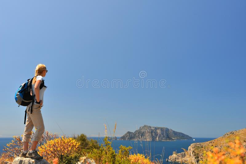 Woman in mountain. Woman stand at top of mountain stock photo