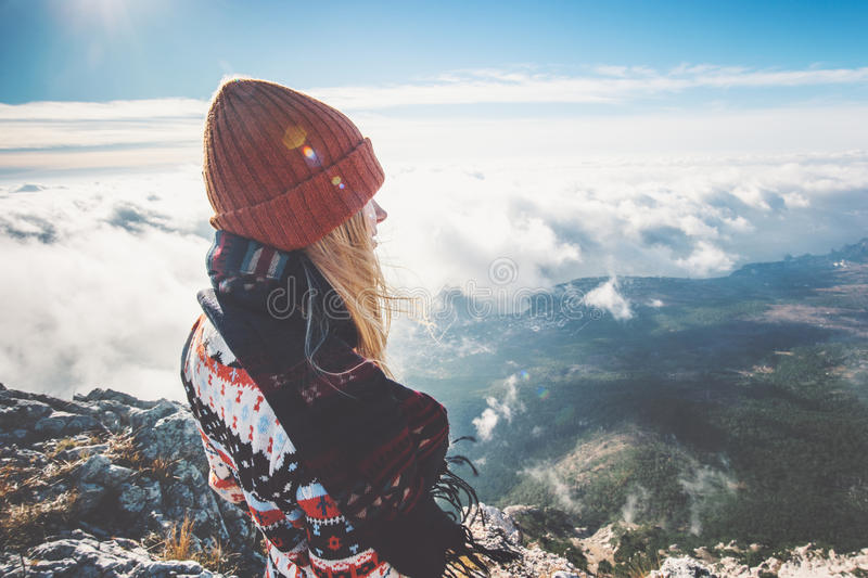 Woman on mountain summit enjoying clouds aerial. View Travel Lifestyle emotions concept adventure active vacations outdoor royalty free stock image