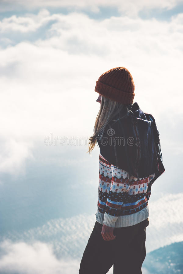 Woman on mountain summit foggy clouds landscape. On background Travel Lifestyle concept adventure vacations outdoor harmony with nature royalty free stock photos