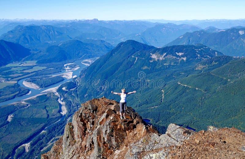 Woman on mountain top. royalty free stock photos