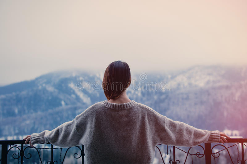 Woman with mountains on background stock photography