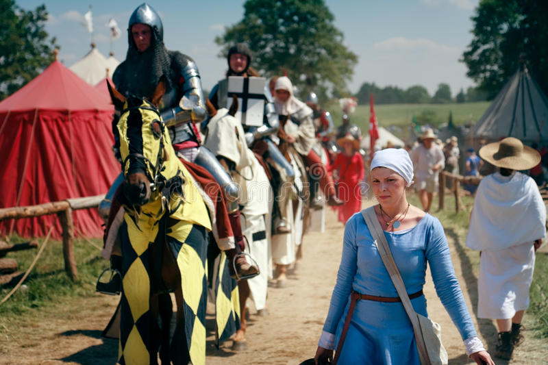 Woman and mounted knights royalty free stock images