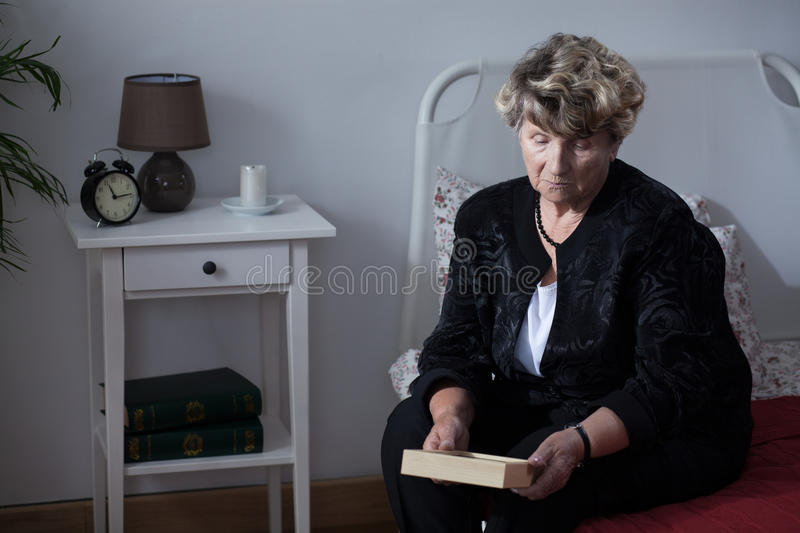 Woman mourning her dead husband stock photo
