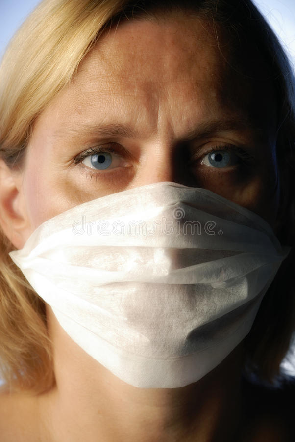 Woman with Mouth Guard. Portrait of a woman with mask and anxious glance stock photography