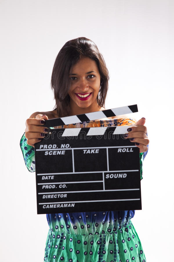 Woman with a movie clapper royalty free stock photo