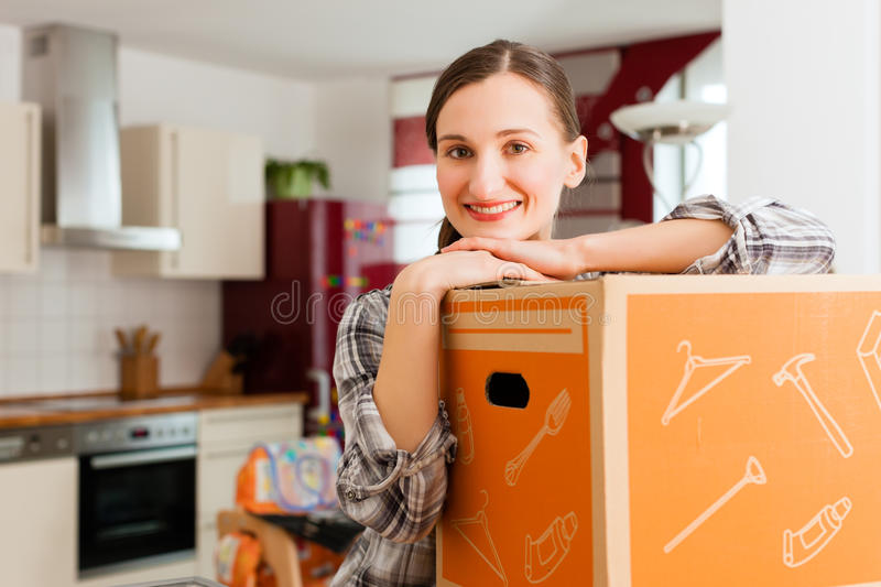 Download Woman With Moving Box In Her House Stock Photo - Image: 26622312