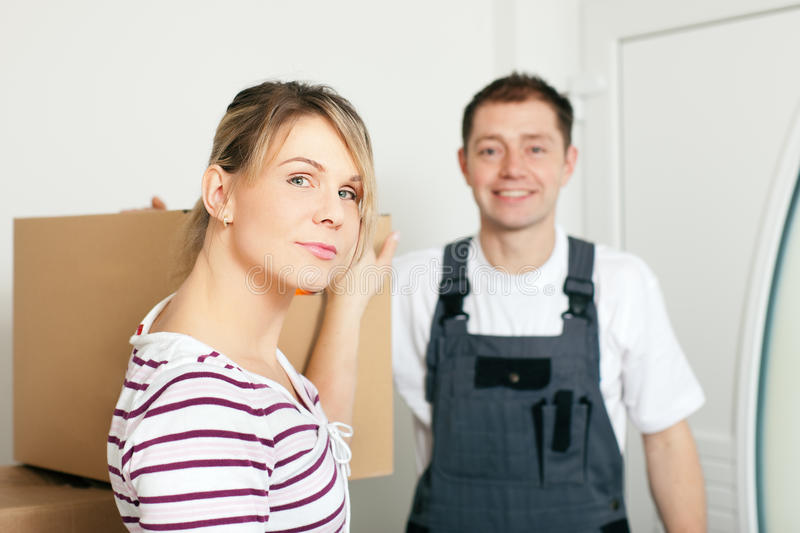 Woman moving in her new house royalty free stock images