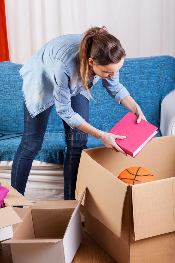 Woman moving house royalty free stock images