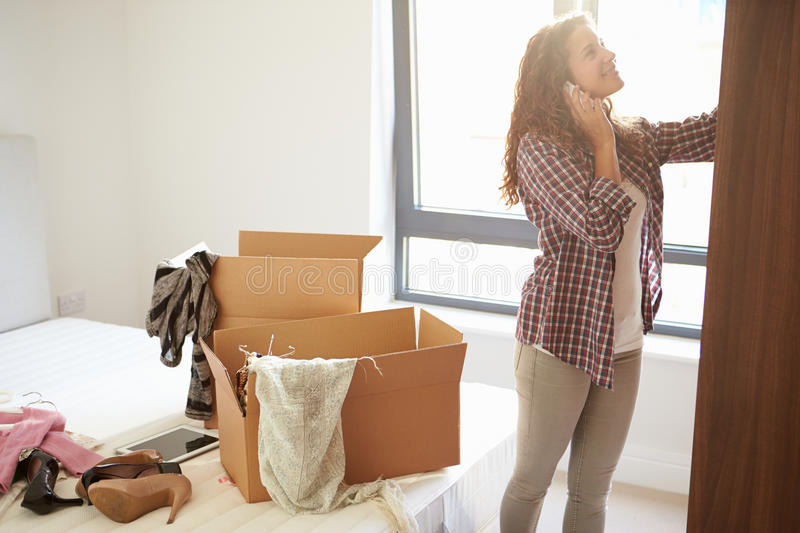 Download Woman Moving Into New Home Talking On Mobile Phone Stock Photo - Image: 34162952