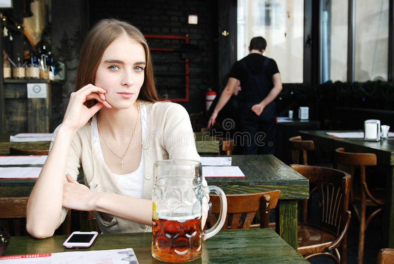 Download Woman With Mug Of Alcohol Beer At The Cafe Royalty Free Stock Image - Image: 23530926