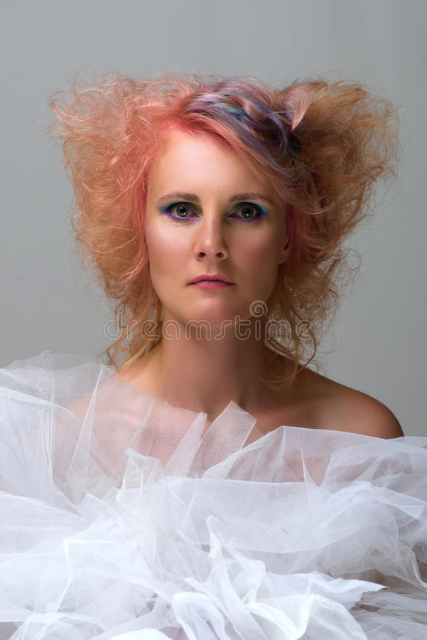 Woman with multi coloured strand in hair. Portrait of a beautiful woman with multi coloured strand in hair, professional hair colouring royalty free stock photography