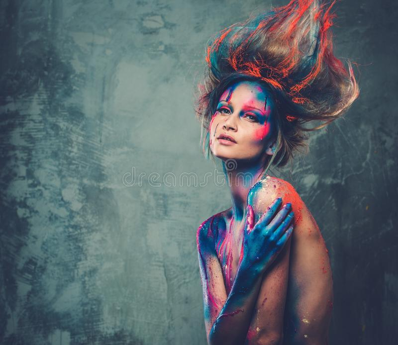 Woman muse with body art. Young woman muse with creative body art and hairdo royalty free stock photos
