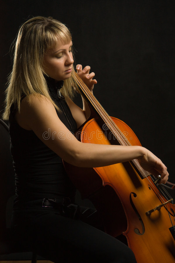 Woman musician with cello stock image