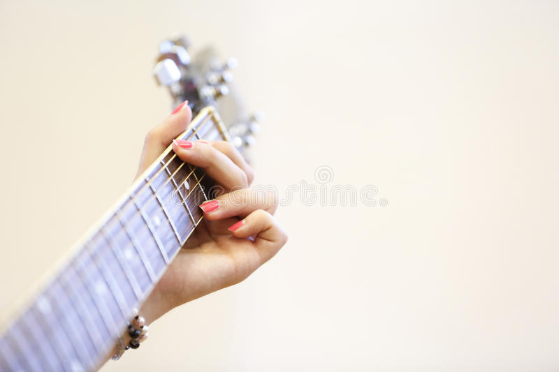 Woman Musician Holding A Guitar Playing A G Chord Stock Image