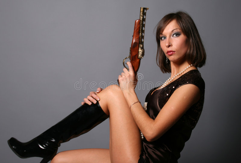 Woman with a musket royalty free stock photography