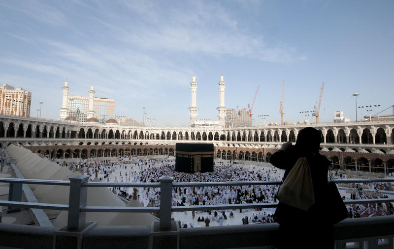 A woman Muslimah takes photo of Kaaba royalty free stock images