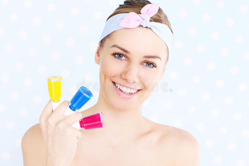 Woman with nail polish stock photo