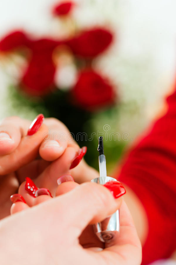 Download Woman In Nail Salon Receiving Manicure Stock Photo - Image: 19244706