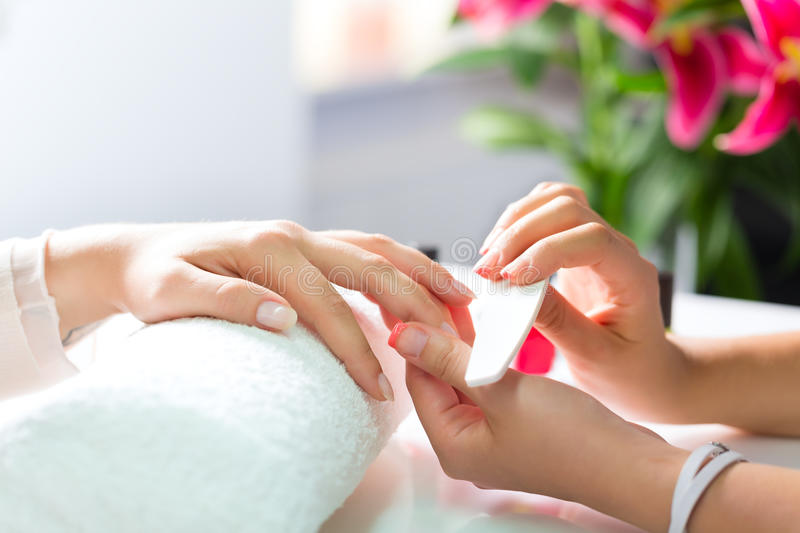Download Woman In Nail Salon Receiving Manicure Stock Photo - Image of nail, beautiful: 28557756