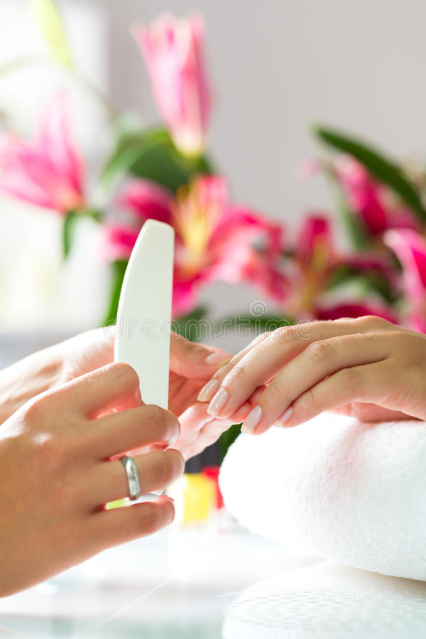 Download Woman In Nail Salon Receiving Manicure Stock Photo - Image of people, beautician: 29150852
