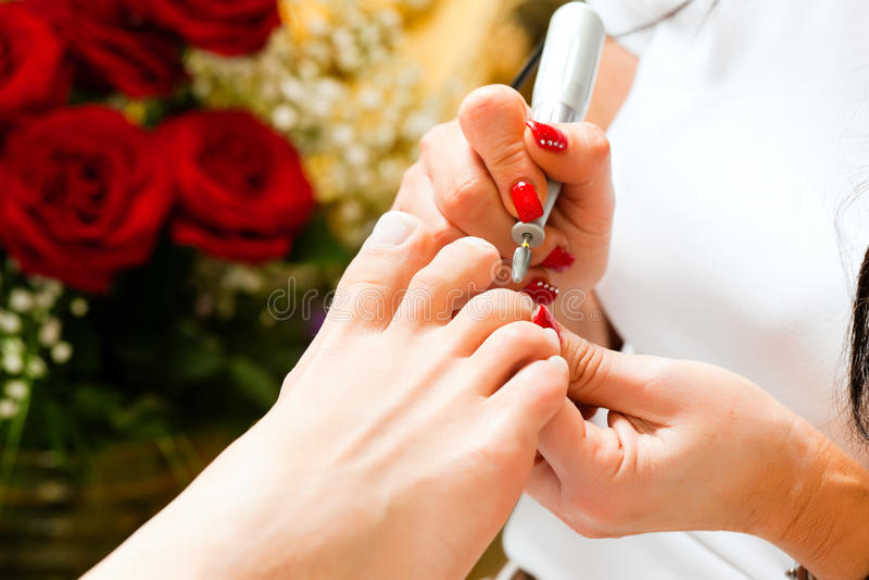 Download Woman In Nail Studio Receiving Pedicure Stock Photo - Image: 18133674
