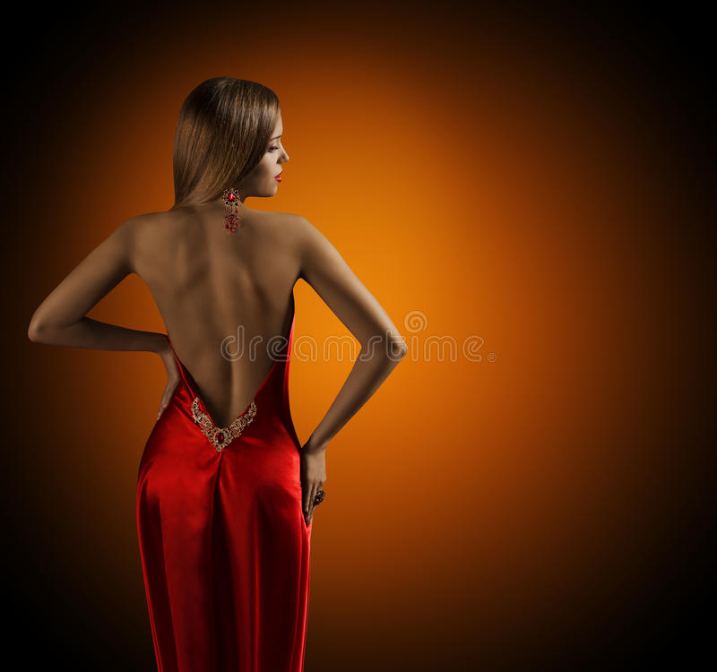 Woman Naked Back, Womanly Fashion Model Posing Red Dress. Elegant Girl Rear View Looking Side over Shoulder stock photography