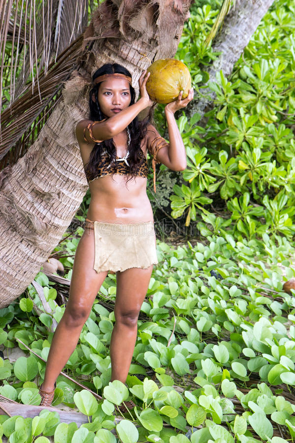 Woman in native dress with coconut stock images