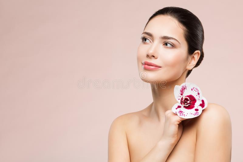 Woman Natural Beauty Makeup Portrait with Flower on Shoulder, Beautiful Girl Skin Care and Treatment stock image