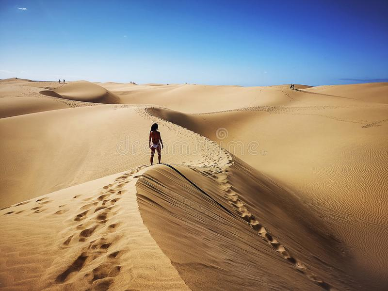Woman in natural reserve of Dunes of Maspalomas in Gran Canaria, Spain royalty free stock photography