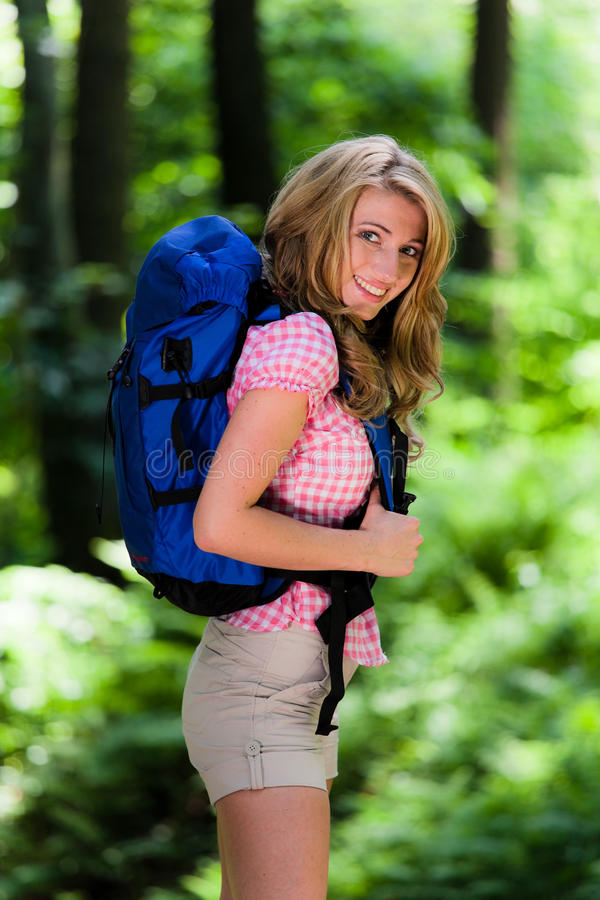 Woman in nature while hiking stock photo