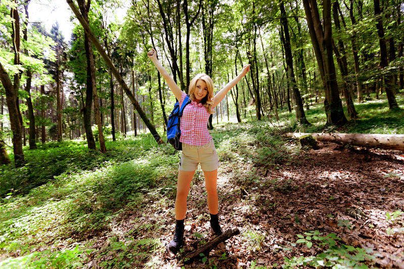 Woman in nature while hiking royalty free stock photography