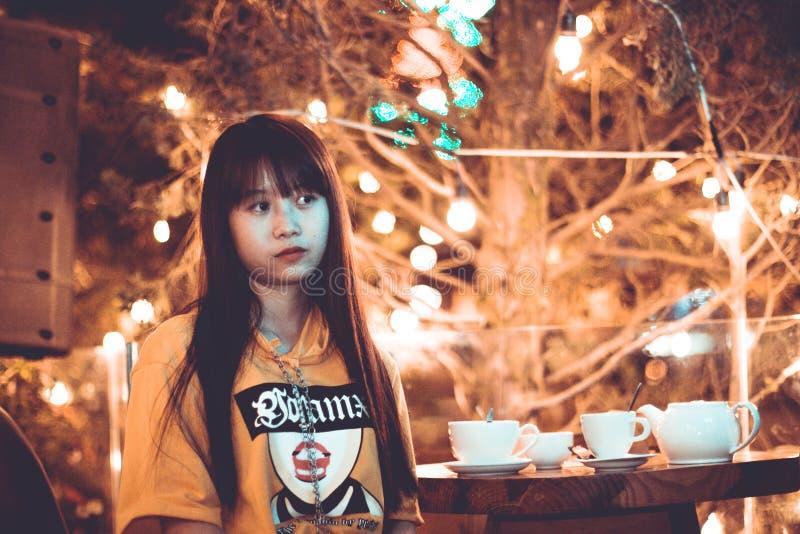 Woman Near Coffee Table stock photo