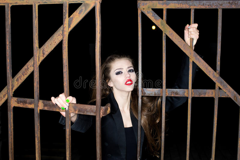 Woman near iron gate royalty free stock images