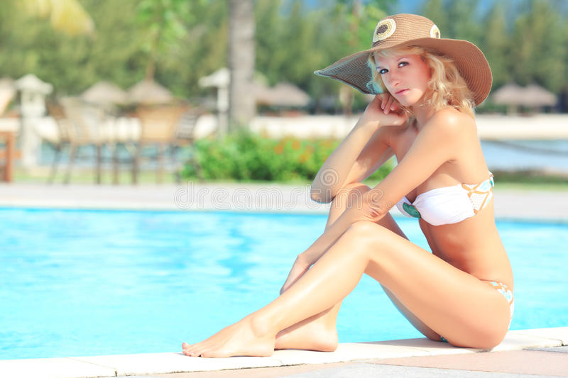Download Woman near swimming pool stock image. Image of garden - 15765669