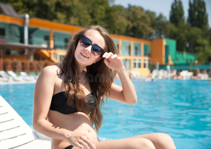 Download Woman near swimming pool stock photo. Image of recreational - 33066578