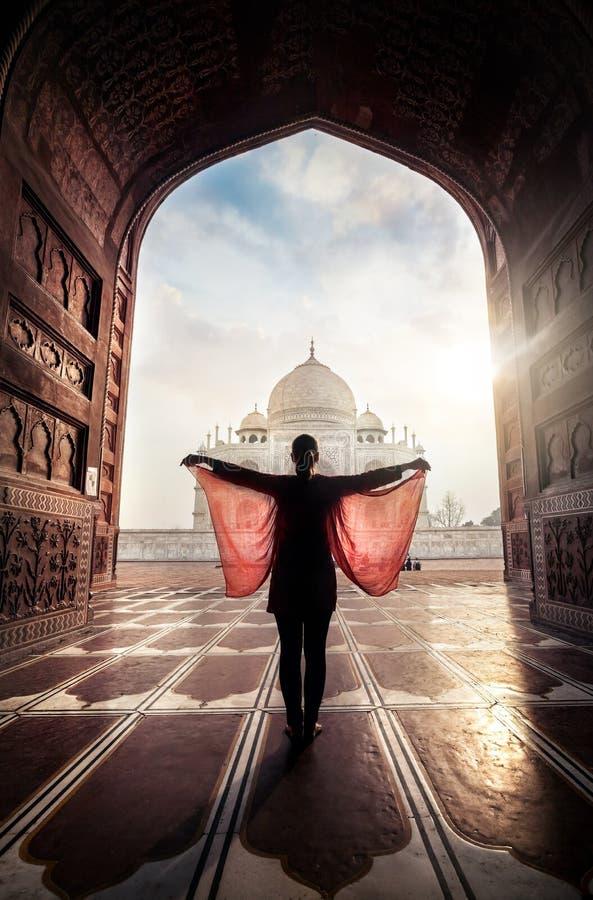 Woman near Taj Mahal. Woman with red scarf posing near Taj Mahal in Agra, Uttar Pradesh, India royalty free stock photography