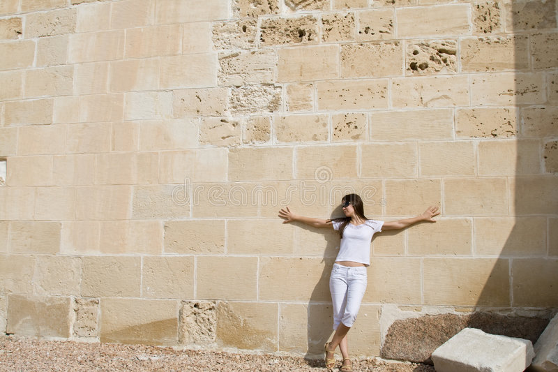 Download Woman Near Wall Royalty Free Stock Photos - Image: 6922448