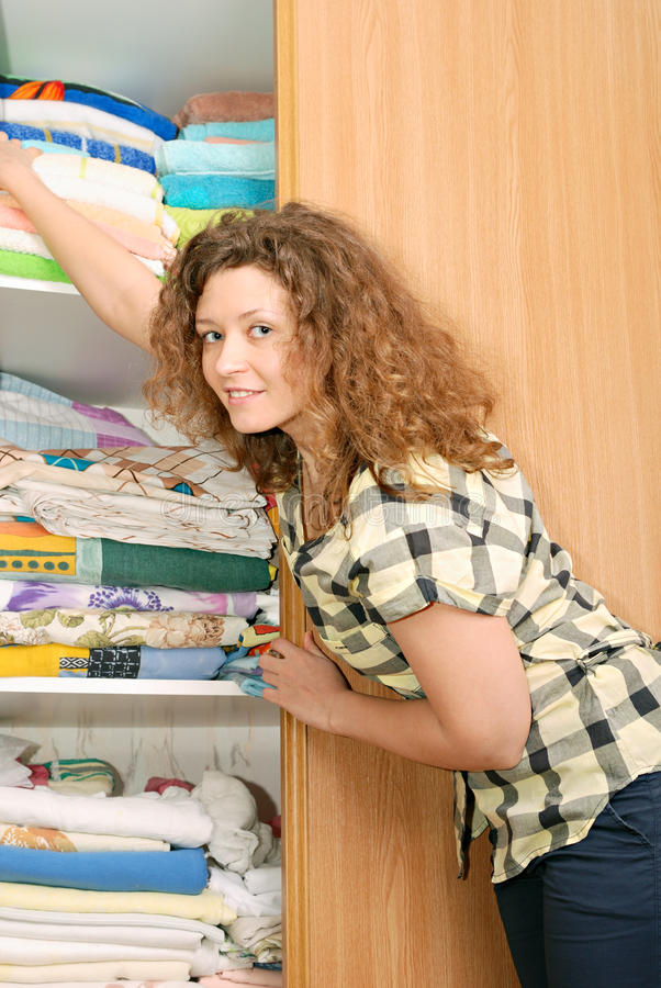 Download Woman Near Wardrobe With Bed Linen Stock Photo - Image: 13541624