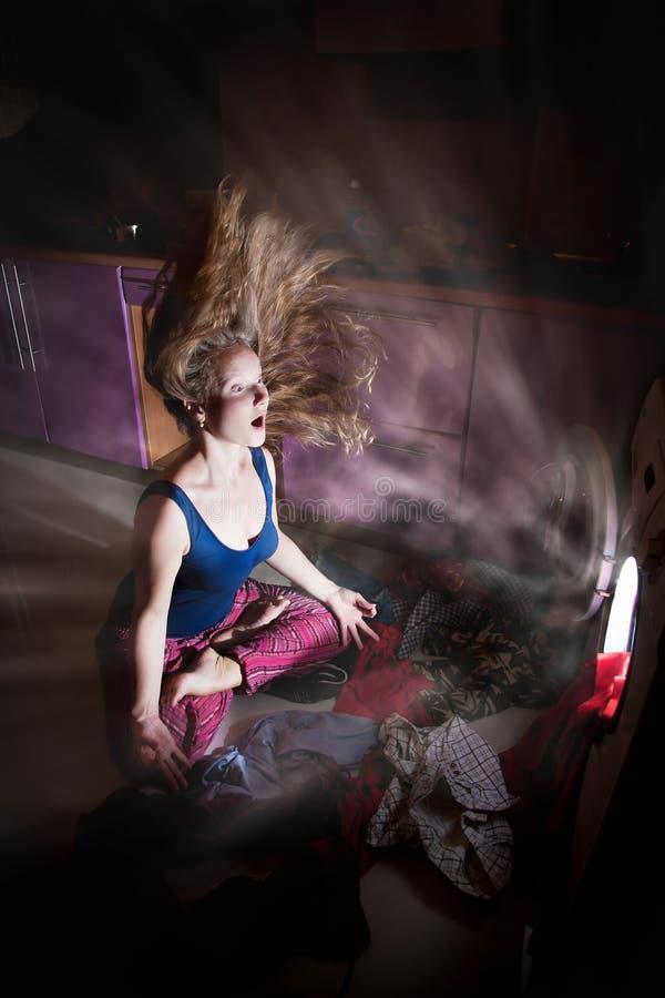 Woman near by washing machine royalty free stock photography