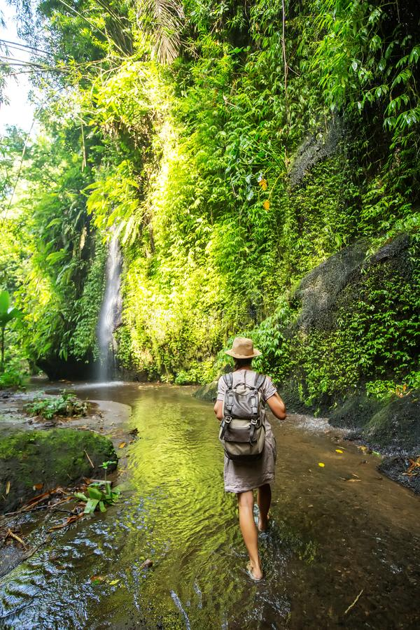 Woman near waterfal on Bali, Indonesia stock images