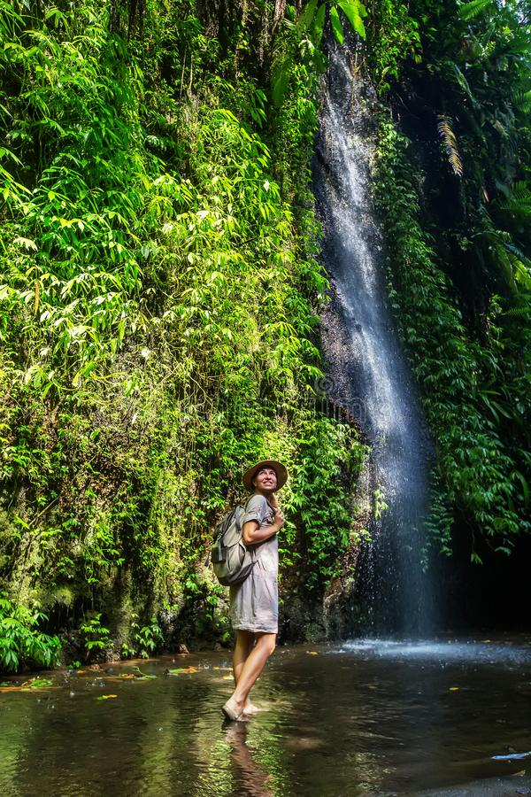 Woman near waterfal on Bali, Indonesia royalty free stock photos
