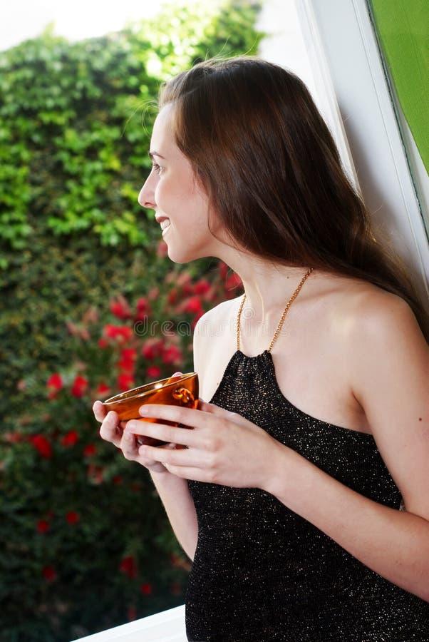 Woman Near A Window Royalty Free Stock Image
