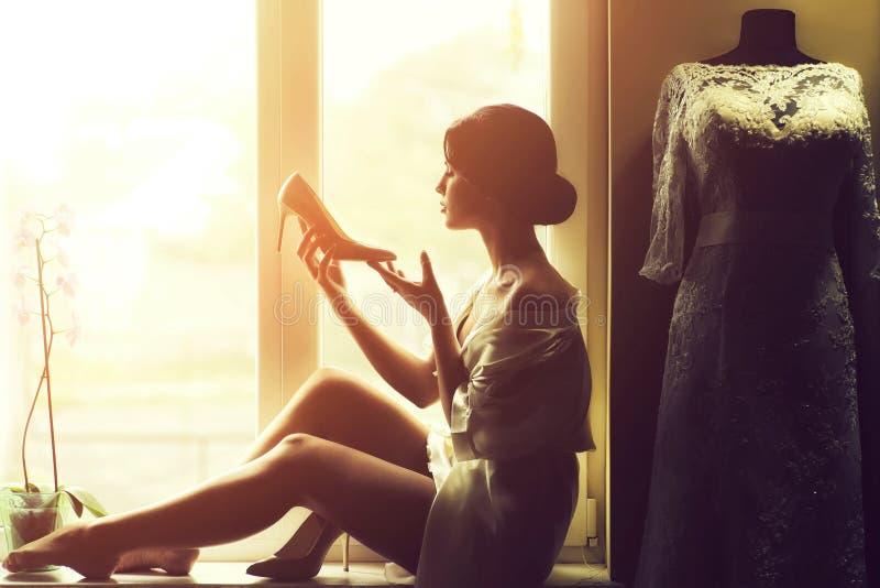 Woman near window stock photo