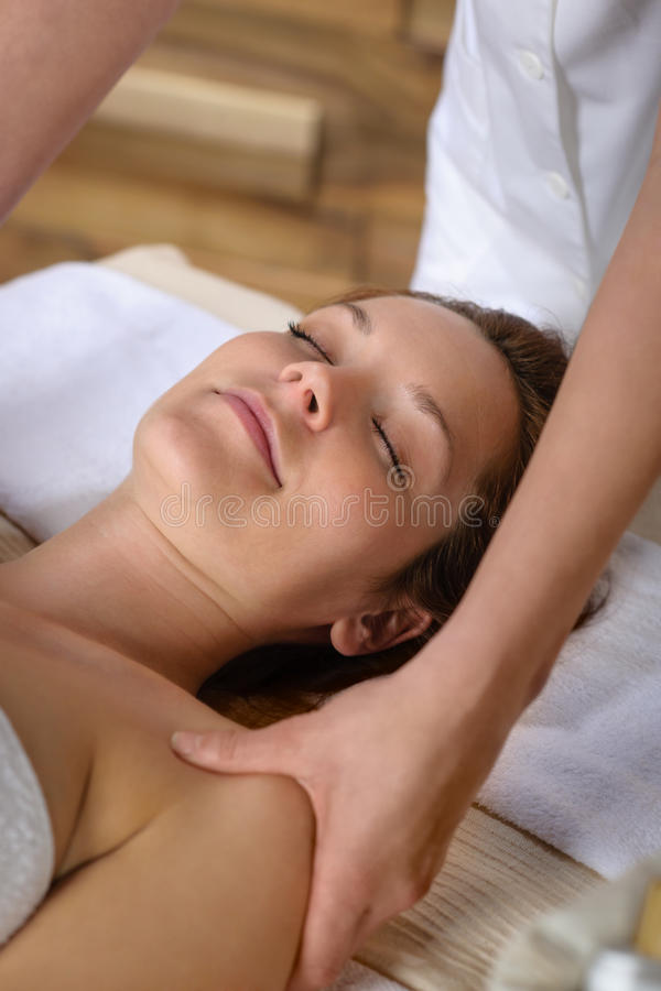 Woman neck massage at luxury spa stock image