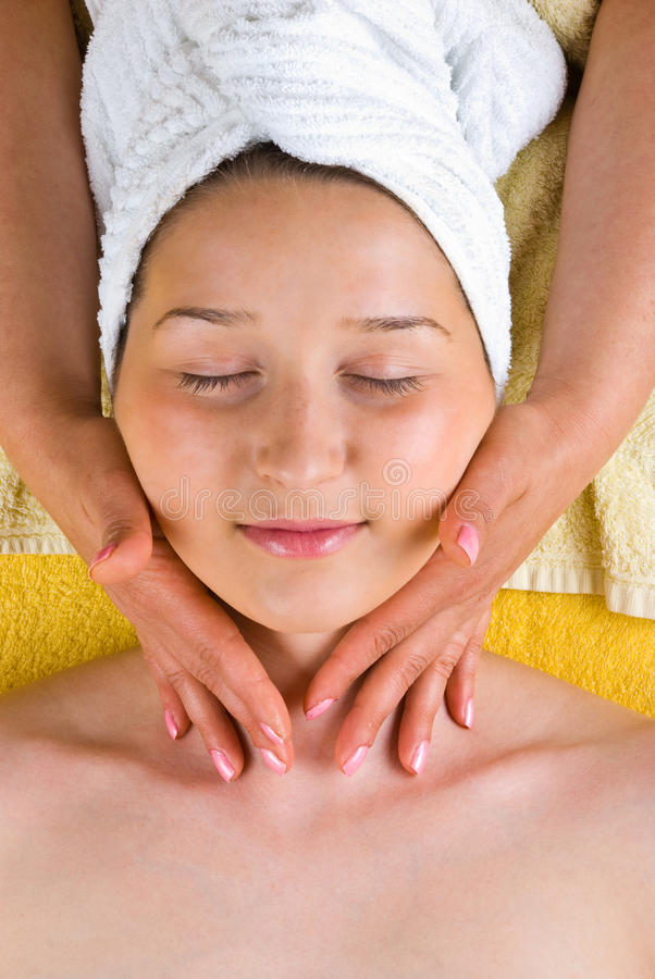 Woman neck massage at spa salon. Beautiful female receiving a soft neck massage from a beautician at spa salon,check also royalty free stock images