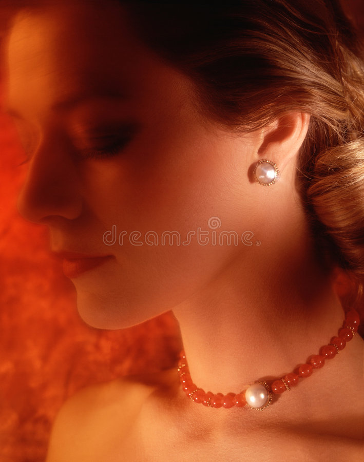 Woman with necklace royalty free stock photography