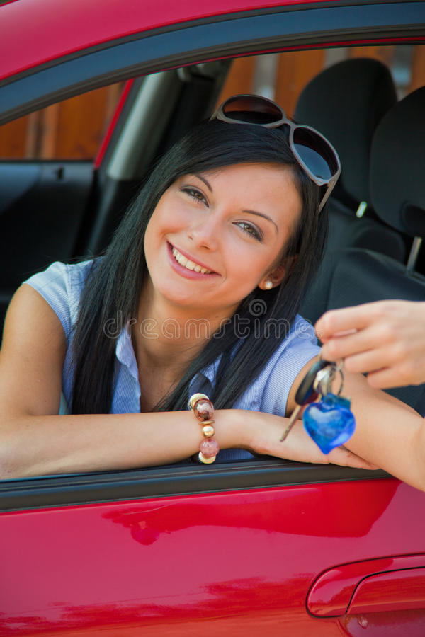 Woman With New Car And Car Keys Royalty Free Stock Photography