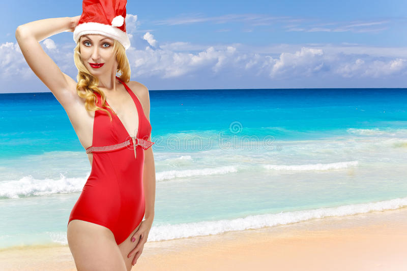 Woman In The New Year S Cap Walks On A Beach Royalty Free Stock Image
